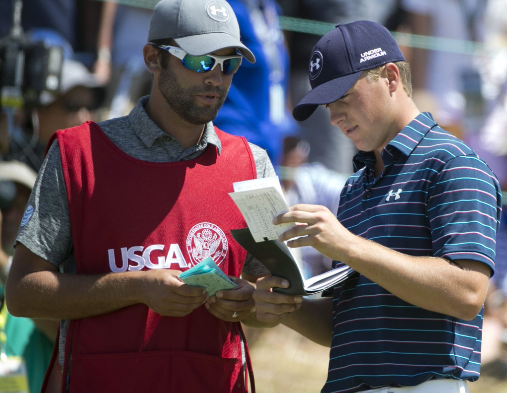 Jordan Spieth and his caddie Michael Greller talk before the final day. (Bettina Hansen / The Seattle Times)