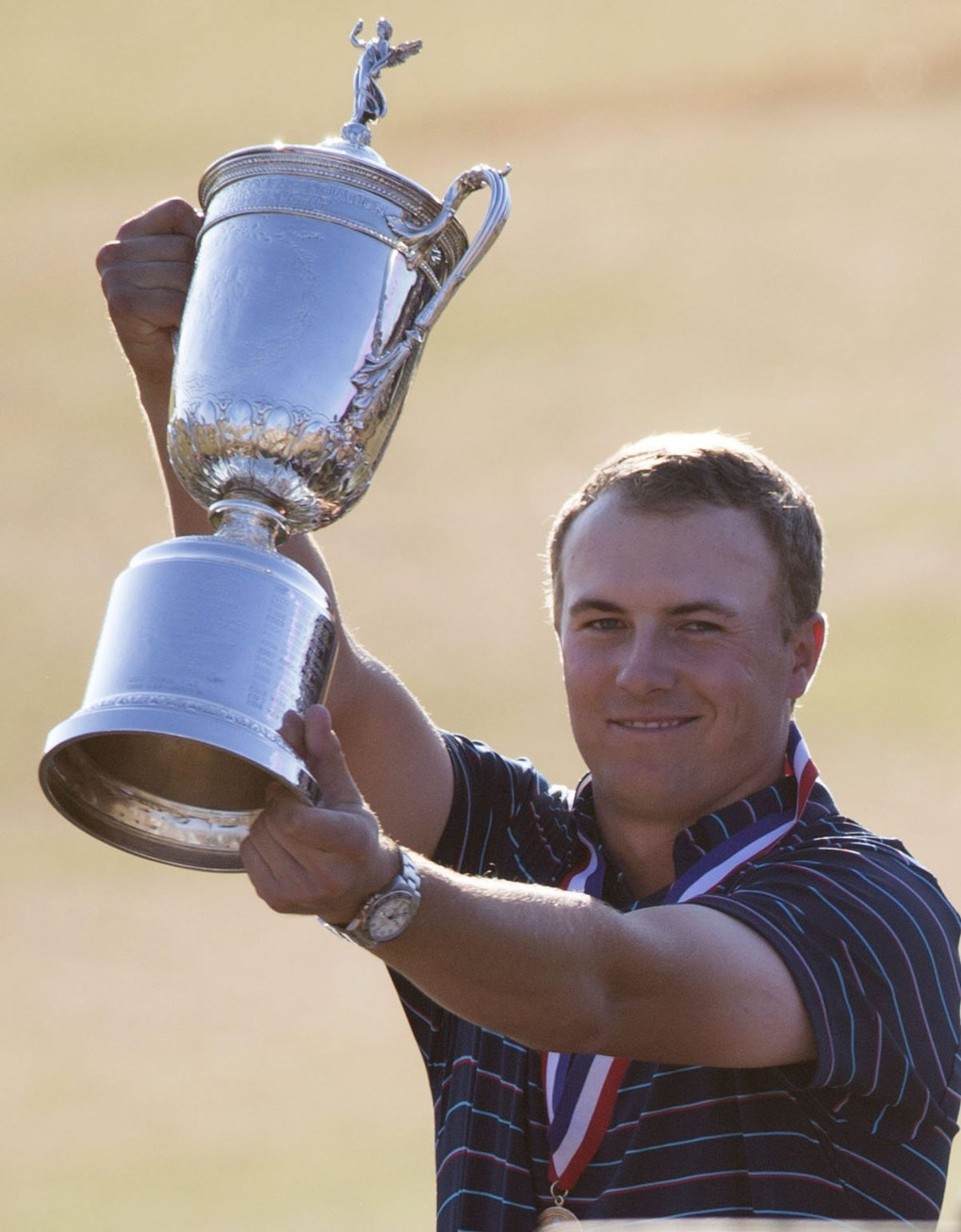 Jordan Spieth holds up the U.S. Open Championship Trophy. (Lindsey Wasson / The Seattle Times)