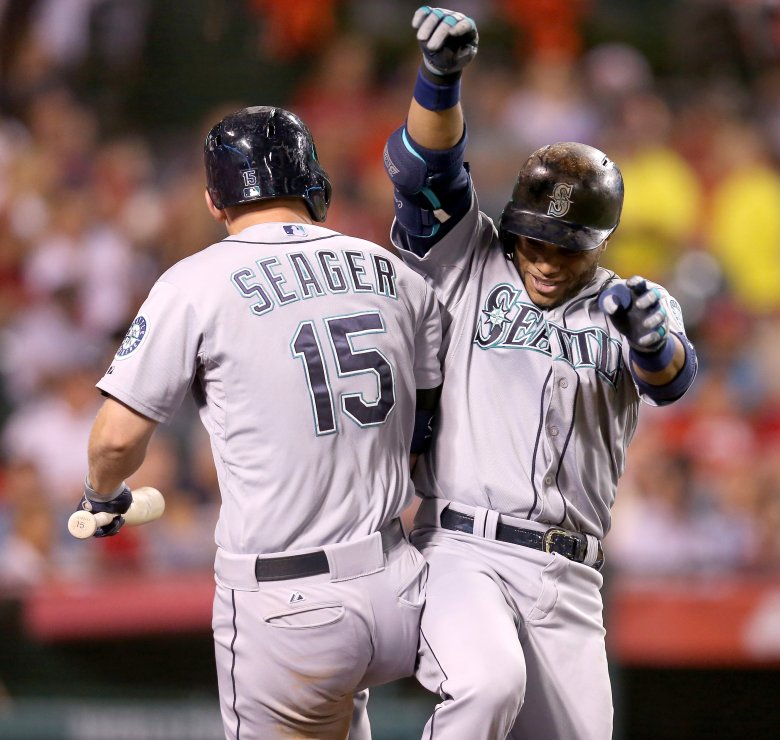 Robinson Cano #22 of the Seattle Mariners celebrates with on-eck hitter Kyle Seager #15 as he returns to the dugout after hitting a solo home run in the eighth inning against the Los Angeles Angels of Anaheim at Angel Stadium. (Stephen Dunn/Getty Images)