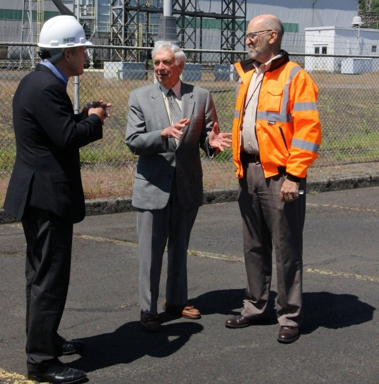 Millennium Bulk Terminals' CEO Bill Chapman, left, discusses the proposed coal-export terminal with former Gov. Mike Lowry and Millennium vice president Peter Bennett during a site visit May 28. (Shari Phiel / The Daily News)