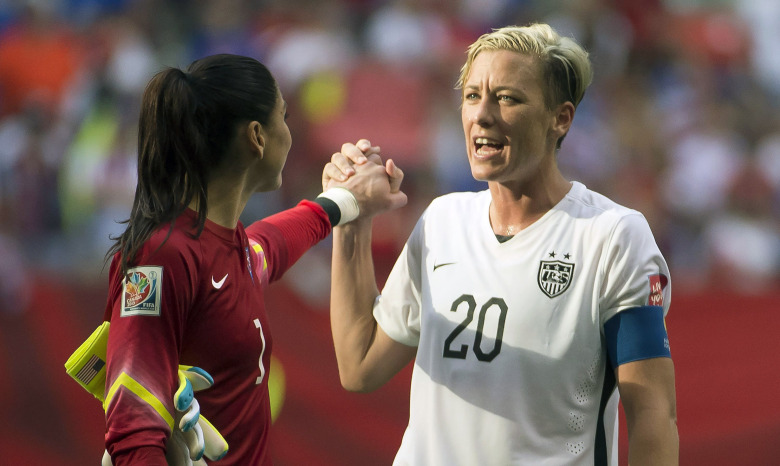 Abby Wambach (20) and U.S. goalkeeper Hope Solo celebrate after Tuesday's 1-0 victory over Nigeria. (Jonathan Hayward/AP)