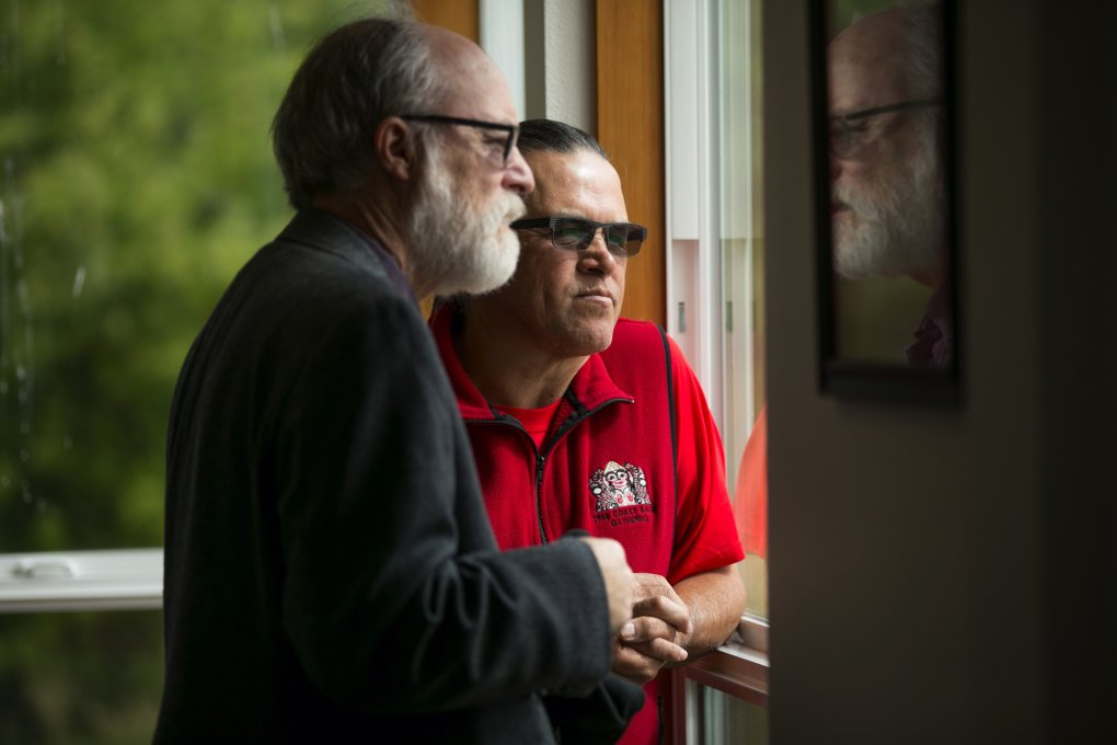 Brian Cladoosby confers at the tribe's dental clinic with administrator John Stephens, who gave him his first adult job. (Bettina Hansen / The Seattle Times)
