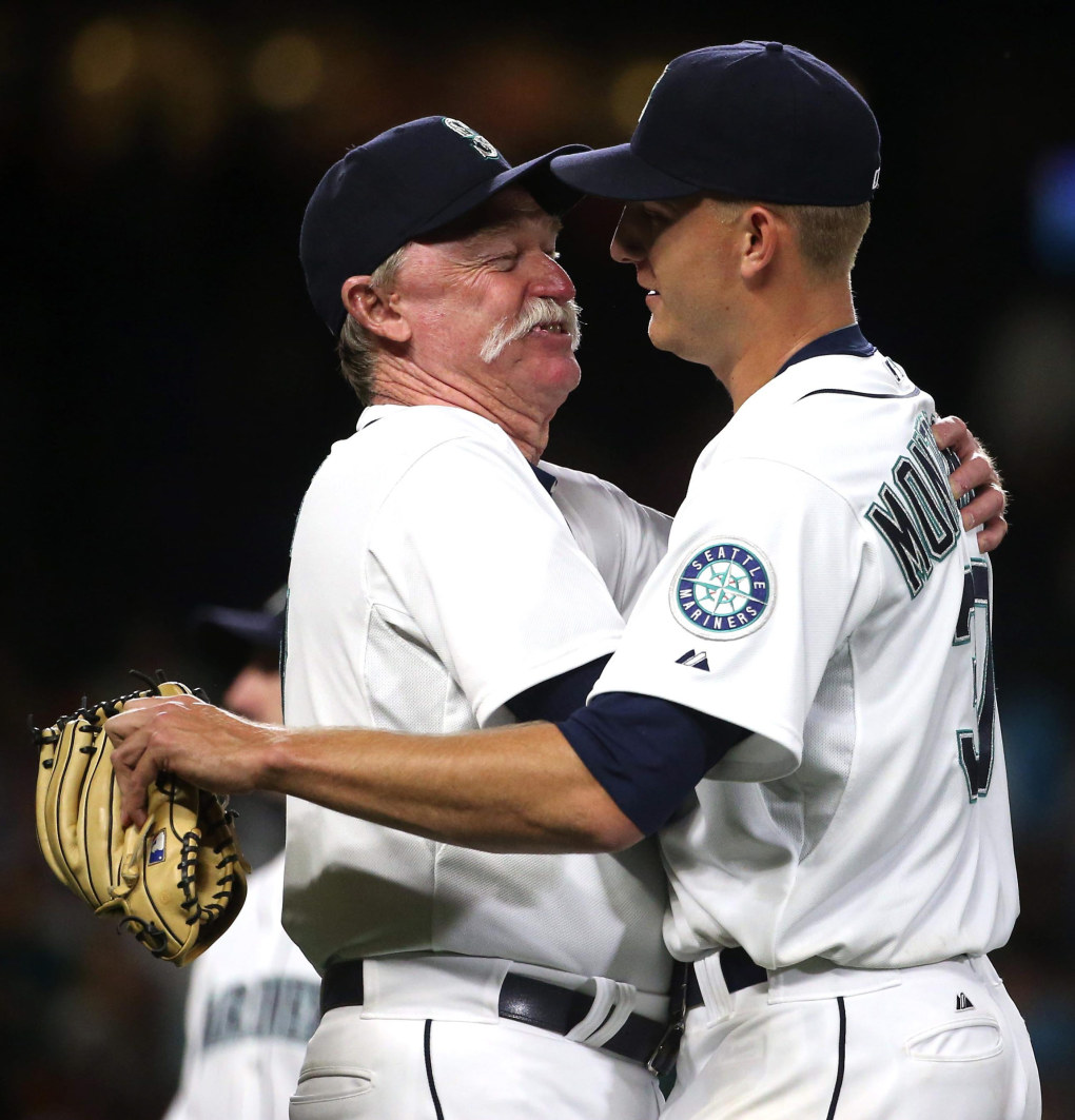 Seattle Mariners Pitching coach Rick Waits embraces pitcher Mike Montgomery (37) after he outed Kansas City Royals' Alex Gordon (4) at first base ending the game 7-0 at Safeco Field.  (Erika Schultz / The Seattle Times)