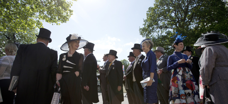 Racegoers arrive for the third day of the Royal Ascot horse racing meet at Ascot, England, Thursday, June 18, 2015. The third day of Royal Ascot is traditionaly known as Ladies day, where fashion and hats come to the fore. (AP Photo/Alastair Grant)
