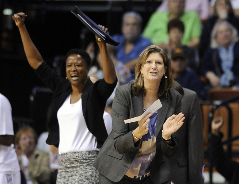 Connecticut Sun head coach Anne Donovan  celebrates during the second half of Connecticut's 82-64 victory over the Atlanta Dream in a WNBA basketball game in Uncasville, Conn., on Sunday, June 14, 2015. (AP Photo/Fred Beckham)