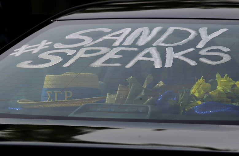 A Sandra Bland hashtag is seen on the window of a mourners' car at the DuPage African Methodist Episcopal Church Saturday, July 25, 2015, in Lisle, Ill. Bland was a member of Sigma Gamma Rho Sorority Inc. a service based organization. An autopsy report released Friday found that Bland used a plastic trash bag to hang herself three days after a confrontational traffic stop. The 28-year-old woman's family has questioned the findings, saying she was excited about starting a new job and wouldn't have taken her own life. (AP Photo/Christian K. Lee)