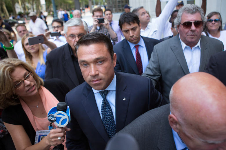 Former U.S. Rep. Michael Grimm, center, leaves following his sentencing at federal court Friday, July 17, 2015, in the Brooklyn borough of New York.  Grimm was sentenced to 8 months in prison on Friday for tax evasion.  (AP Photo/Kevin Hagen)