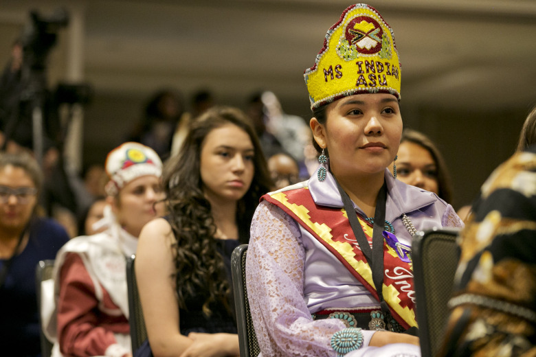 """CORRECTS SPELLING OF OVERTURF – Brooke Overturf, of the Navajo Nation and from Window Rock, Ariz., listens to first lady Michelle Obama speak at the first White House Tribal Youth Gathering, Thursday, July 9, 2015 in Washington.  Michelle Obama on Thursday told hundreds of Native American youth that they are all precious and sacred and that """"each of you was put on this earth for a reason."""" (AP Photo/Jacquelyn Martin)"""