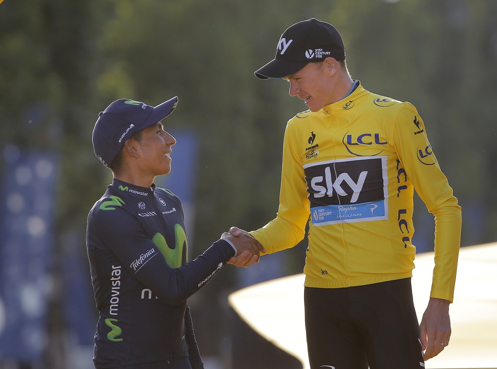 Race winner Britain's Chris Froome, right, shakes hands with second placed Colombia's Nairo Quintana at the end of the Tour de France cycling race in Paris, France, Sunday, July 26, 2015 (AP Photo/Laurent Cipriani)