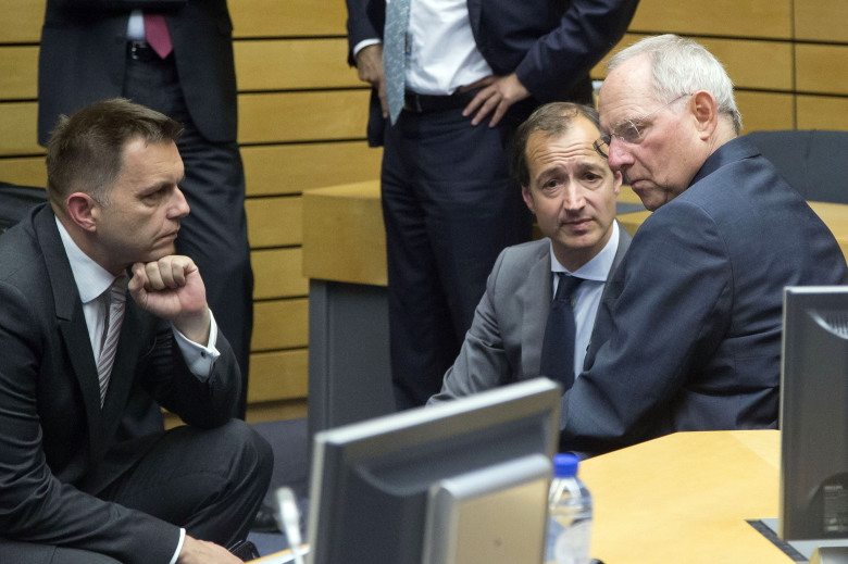 German Finance Minister Wolfgang Schaeuble, right, speaks with Slovakian Finance Minister Peter Kazimir, left, during  a meeting of eurozone finance ministers at the EU Lex building in Brussels on Saturday, July 11, 2015. Greece's negotiators head to Brussels on Saturday armed with their reform proposals and parliamentary backing to seek a third bailout, but with the shadow of severe dissent from governing lawmakers hanging over them. (AP Photo/Michel Euler)