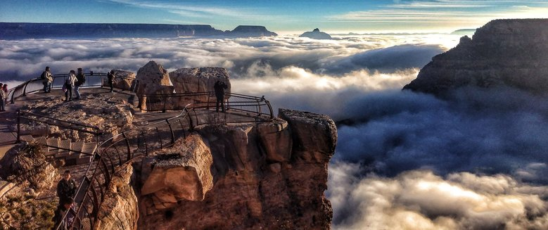 Visitors to Mather Point at Grand Canyon National Park, Ariz., look out over a rare total cloud inversionin 2013.  (Erin Whittaker/The Associated Press)