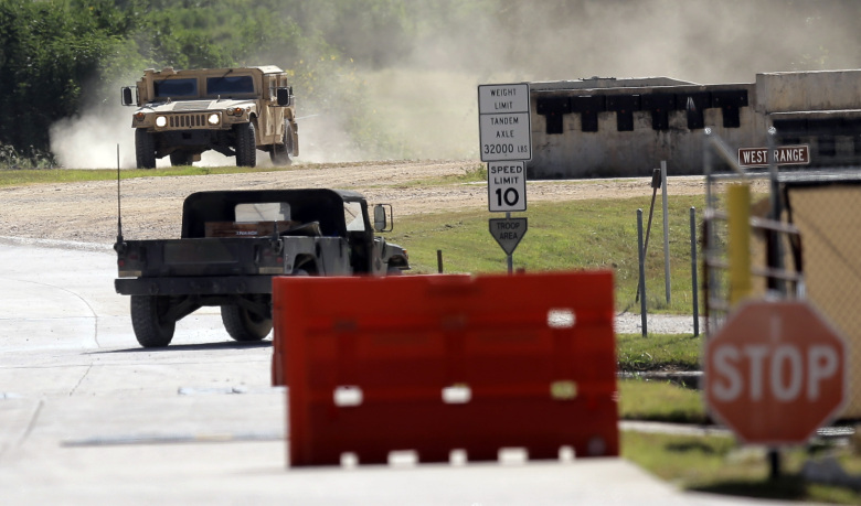 Military vehicles are seen at Texas Army National Guard Camp Swift, Wednesday, July 15, 2015, in Bastrop, Texas. Jade Helm 15, a summer military training exercise, that has aroused alarm among archconservative Texans, begins Wednesday outside the Central Texas town of Bastrop. (AP Photo/Eric Gay)
