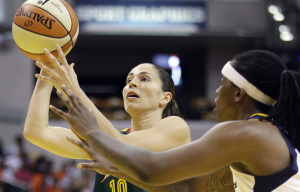 Seattle Storm's Sue Bird (10) puts up a shot against Indiana Fever's Lynetta Kizer (12) during the first half of a WNBA basketball game Wednesday, July 8, 2015, in Indianapolis. (AP Photo/Darron Cummings)