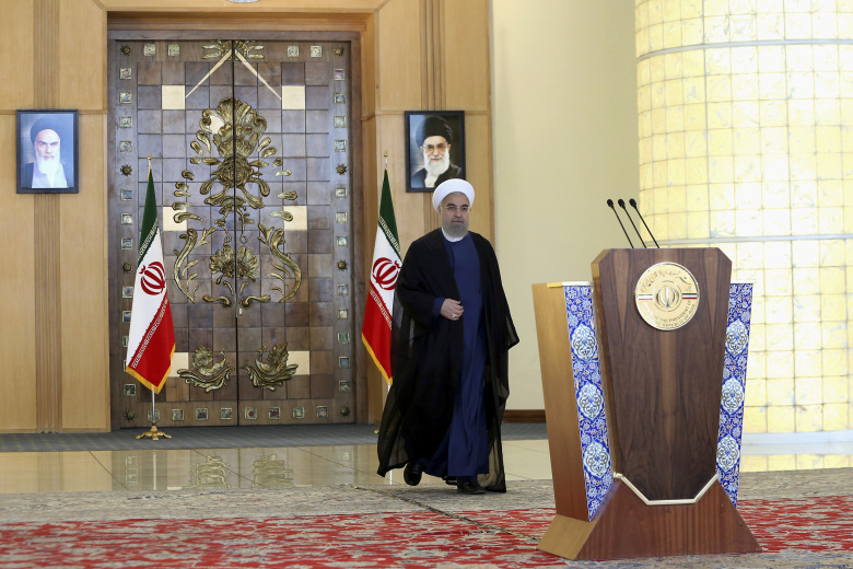 Iran's president Hassan Rouhani arrives for an address to the nation after a nuclear agreement was announced in Vienna, in Tehran, Iran, Tuesday, July 14, 2015. After long, fractious negotiations, world powers and Iran struck a historic deal Tuesday to curb Iran's nuclear program in exchange for billions of dollars in relief from international sanctions – an agreement aimed at averting the threat of a nuclear-armed Iran and another U.S. military intervention in the Middle East. (AP Photo/Ebrahim Noroozi)