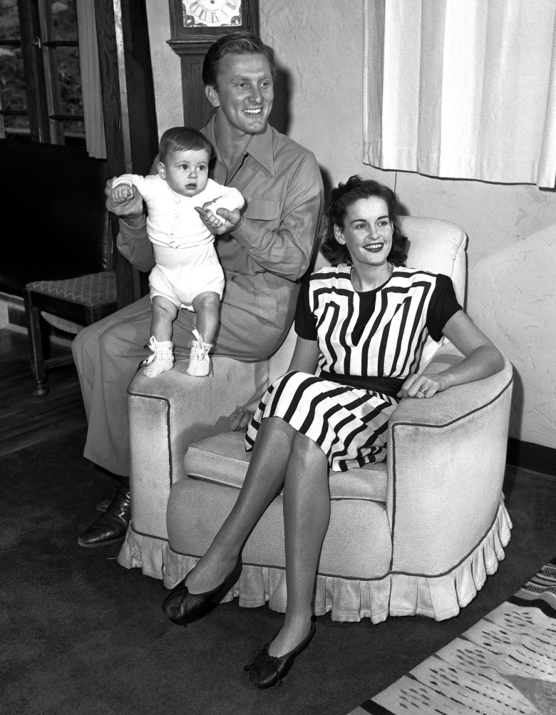 FILE – In this Sept. 9, 1947 file photo, actors Kirk and Diana Douglas pose with their second son, Joel, for his first portrait in the Hollywood district of Los Angeles.  Diana Douglas, the first wife of Kirk Douglas and mother of Michael Douglas, has died in Los Angeles. She was 92. Michael Douglas's production company says she died of cancer on Saturday at a movie industry retirement home in Woodland Hills.(AP Photo, File)