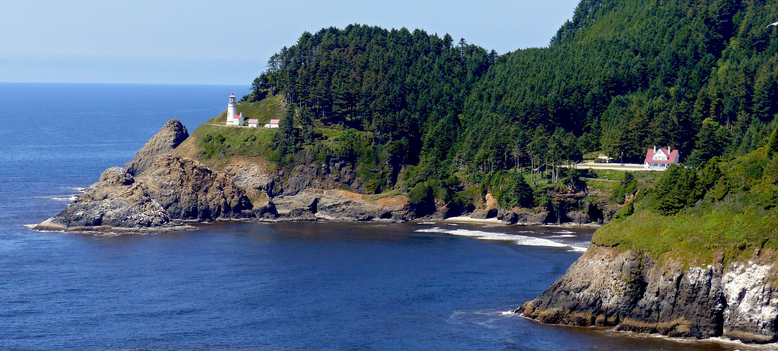 The lighthouse keepers' quarters (a B&B), right, is a short walk on a gravel path from Heceta Head Lighthouse. (Brian J. Cantwell/The Seattle Times)