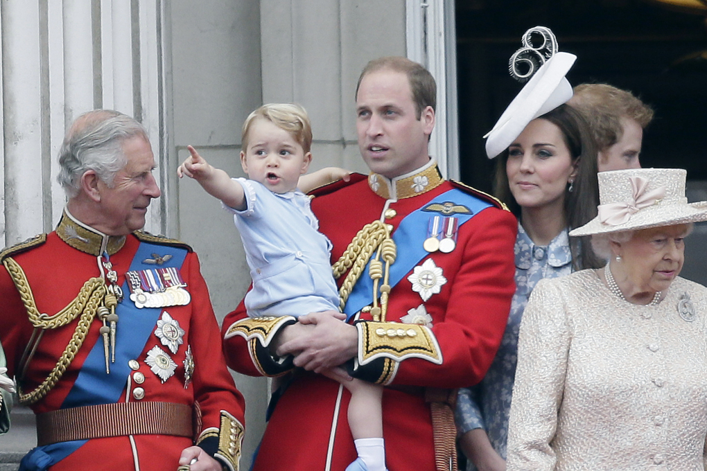 FILE – In this Saturday, June 13, 2015 file photo, Britain's Prince William holds his son Prince George, with Queen Elizabeth II, right, Kate, Duchess of Cambridge and the Prince of Wales during the Trooping The Colour parade at Buckingham Palace, in London. Britain's royals on Wednesday July 22 2015 celebrate the second birthday of George, the first child of Prince William and his wife, Kate. (AP Photo/Tim Ireland, file)