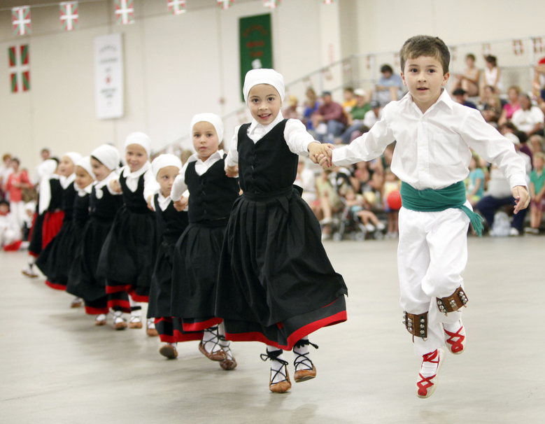 John Lejardi, 6, right, and Tea Uranga lead fellow dancers from the Basque dance group Herribatza Danzariak in Boise, Idaho, during the 2010 Jaialdi festival in southwestern Idaho. One of the largest Basque communities in the United States will spend the next five days celebrating the traditional Jaialdi festival in southwestern Idaho. An estimated 35,000 to 50,000 people are expected to attend the event. (Darin Oswald/AP)