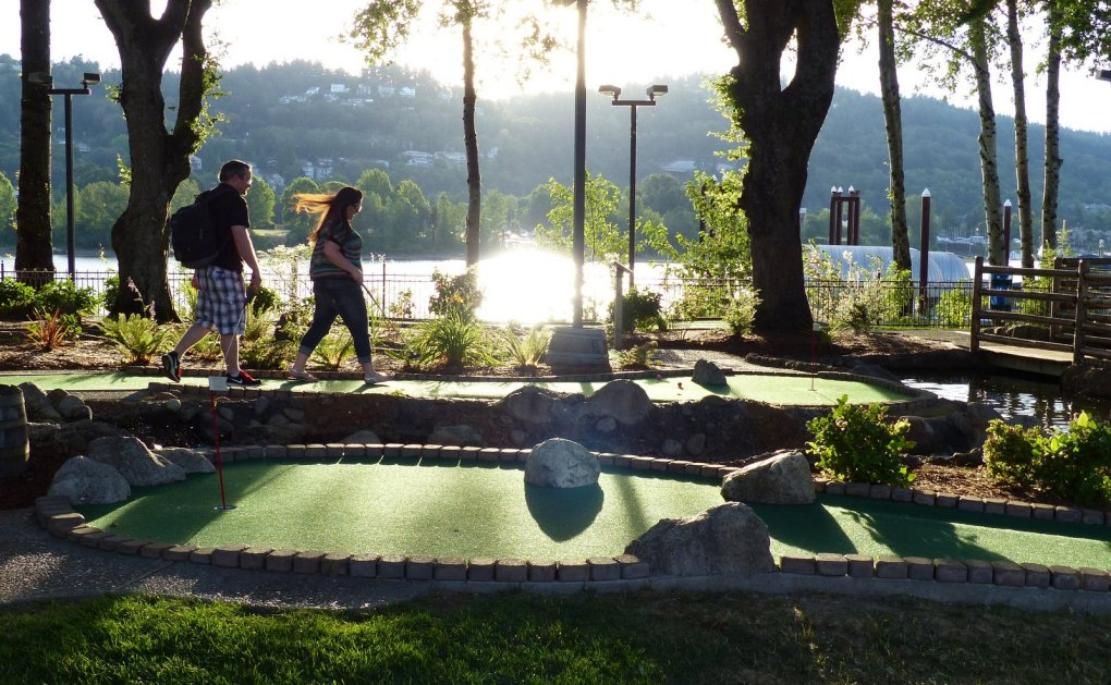 Players walk the greens at the scenic miniature-golf course fronting the Willamette River at Portland's Oaks Park amusement park.  (Brian J. Cantwell/The Seattle Times)