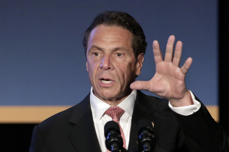 """New York Gov. Andrew Cuomo addresses the Association for a Better New York luncheon, in New York, Monday, July 27, 2015. Cuomo introduced a plan to redesign and rebuild New York City's LaGuardia airport. The airport in Queens is one of the busiest in the nation, but is cramped and outdated. Vice President Joe Biden last year dubbed it a """"Third World country."""" (AP Photo/Richard Drew)"""