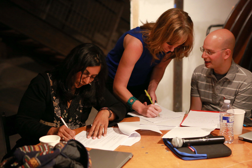 City Council member Kshama Sawant, left, goes over her speech with Sarah White, a full-time nurse and Socialist Alternative member and political director Philip Locker on election night before results are announced. (Bettina Hansen / The Seattle Times)