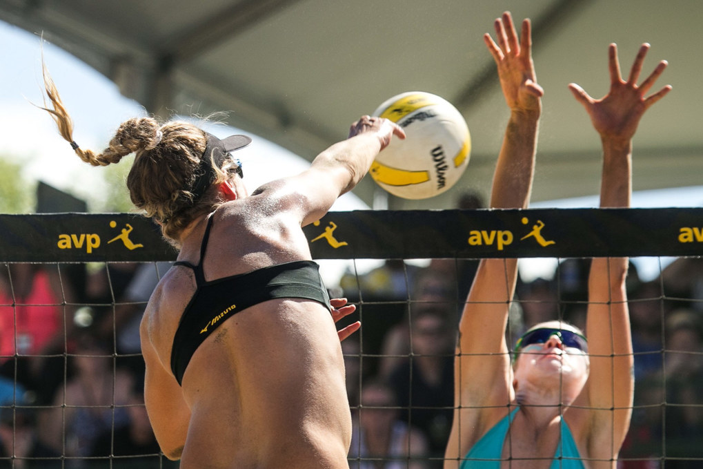 April Ross spikes the ball hard past Summer Ross in the women's final at the AVP Seattle Open at Lake Sammamish State Park in Issaquah.   Lane Carico and Summer Ross lost in three sets to Jennifer Fopma and April Ross.  (Bettina Hansen / The Seattle Times)