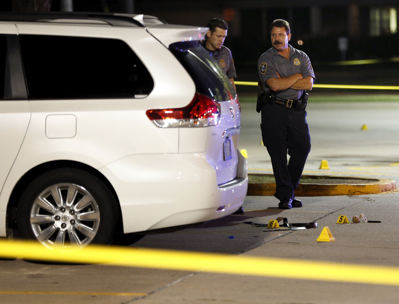 Police investigate the scene where Oklahoma Labor Commissioner Mark Costello was fatally stabbed, Sunday, Aug. 23, 2015, in Oklahoma City. Christian Costello, son of Mark Costello, was arrested on a first-degree murder complaint, police said. (Nate Billings/The Oklahoman via AP) LOCAL STATIONS OUT (KFOR, KOCO, KWTV, KOKH, KAUT OUT); LOCAL WEBSITES OUT; LOCAL PRINT OUT (EDMOND SUN OUT, OKLAHOMA GAZETTE OUT) TABLOIDS OUT; MANDATORY CREDIT