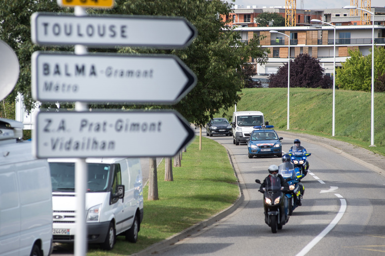CORRECTS LOCATION  A white van, accompanied by police motorcycles and a police car transporting what is believed to be debris from a Boeing 777 plane that washed up on an Indian Ocean island, on route to Direction Generale de L'armement (DGA) facilities in Balma, near Toulouse, south-western France, Saturday, Aug. 1, 2015. A piece of plane wing that could be from missing Malaysia Airlines Flight 370 arrived Saturday in Toulouse, France, for inspection by military aviation experts.The 6-foot-long part, wrapped in a box and shipped as cargo, was flown from the small island of Reunion, near Madagascar. (AP Photo/Fred Lancelot)