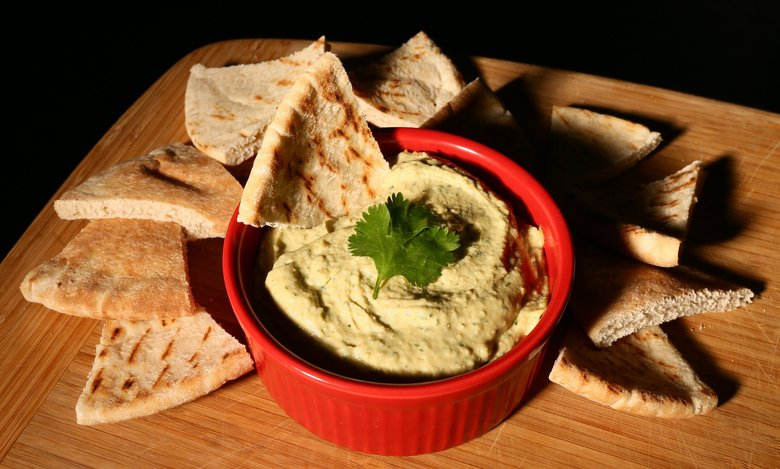 Cilantro and ginger hummus is deceptively easy to make. You just throw a handful of ingredients into a food processor and whip it together until done.  (Robert Cohen/TNS)