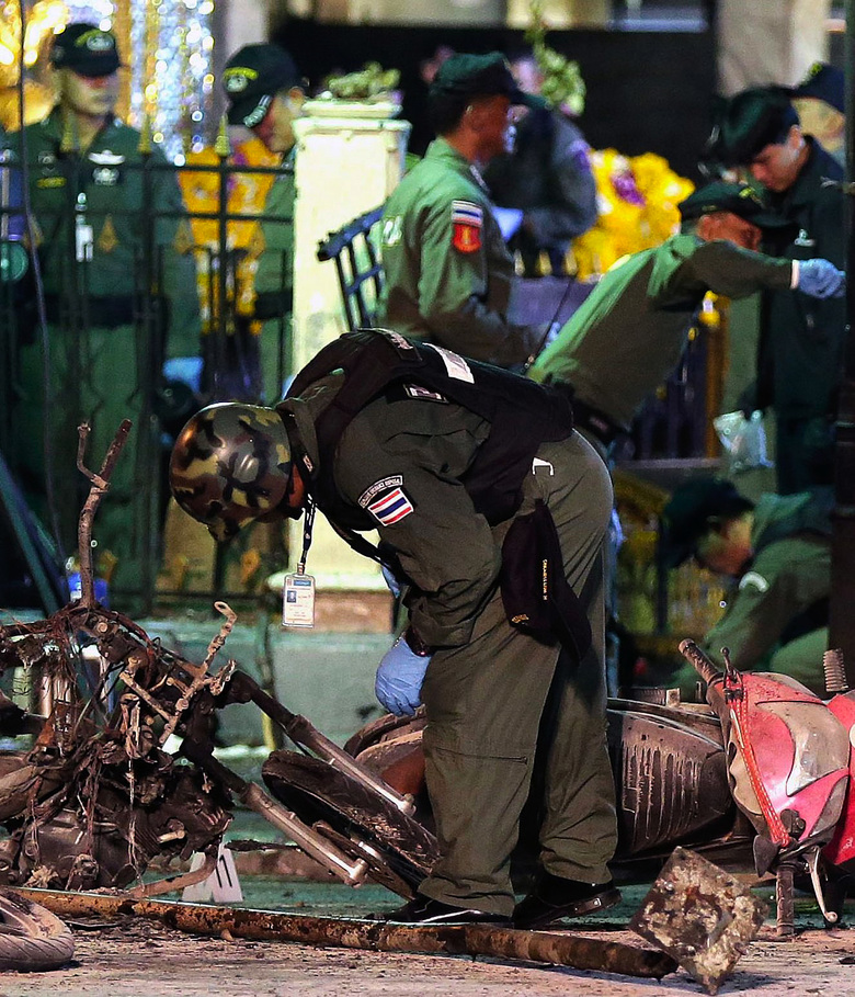 Authorities inspect the scene of Monday's deadly explosion at the Erawan Shrine in Bangkok, Thailand, near the scene of 2014 protests that prompted a military junta to take power. (RITCHIE B. TONGO/EPA)