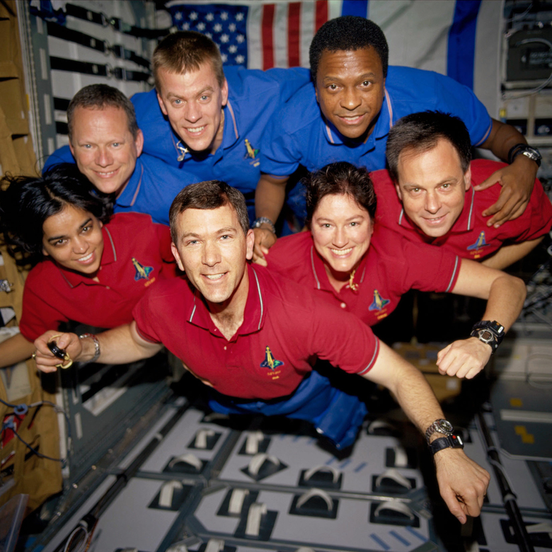 In this undated file photo released in June 2003 provided by NASA STS-107 crew members pose aboard the Space Shuttle Columbia. On Feb. 1, 2003, the seven crew members were lost as the Columbia fell apart over East Texas. This picture was on a roll of unprocessed film later recovered by searchers from the debris. From the left (bottom row), wearing red shirts to signify their shift's color, are mission specialist Kalpana Chawla, commander, Rick D. Husband, mission commander Laurel B. Clark and Ilan Ramon, payload specialist. From the left (top row), wearing blue shirts, are mission specialist David M. Brown, pilot William C. McCool, pilot; and payload commander Michael P. Anderson. (NASA via AP, File)