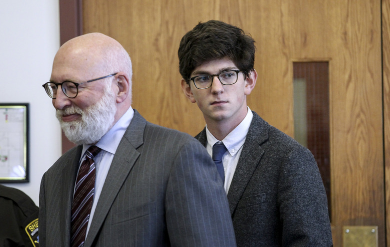 Looking in the direction of the victim's family, former St. Paul's School student Owen Labrie, right, enters the courtroom with his defense attorney J.W. Carney, left, for closing remarks in Labrie's rape trial at Merrimack Superior Court Thursday, Aug. 27, 2015, in Concord, N.H. Labrie is charged with raping a 15-year-old freshman as part of Senior Salute, in which seniors try to romance and have intercourse with underclassmen before leaving the prestigious St. Paul's School in Concord. The defense contends the two had consensual sexual contact but not intercourse. (AP Photo/Cheryl Senter, Pool)