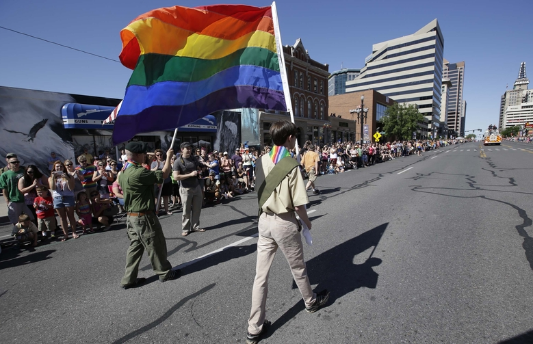 FILE – In this June 8, 2014, file photo, a group of Boy Scouts march during the Salt Lake City's annual gay pride parade, in Salt Lake City. The Mormon church, the nation's largest sponsor of Boy Scout units, is keeping its longtime affiliation with the organization despite its decision to allow gay troop leaders. Church leaders decided to stay with the Boy Scouts after getting assurances they can appoint troop leaders according to their own religious and moral values, The Church of Jesus Christ of Latter-day Saints said in a news release Wednesday, Aug. 26, 2015. (AP Photo/Rick Bowmer, File)