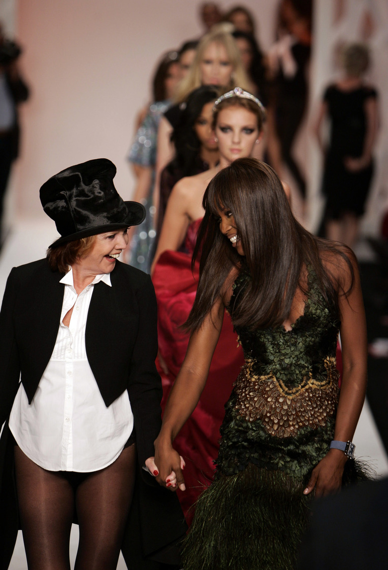 FILE – In this Wednesday, Sept. 17, 2008 file photo, British model Naomi Campbell, right, along with Cilla Black walk on the catwalk at the end of the Fashion For Relief show, during London Fashion Week at the Natural History Museum in central London. Spanish police said Sunday that the singer, who had a home in Estepona, southern Spain, died Saturday, Aug. 1, 2015. Born Priscilla White, Black worked as a teenager in the cloakroom of Liverpool's Cavern Club, where her musical talent was spotted by The Beatles. (AP Photo/Lefteris Pitarakis, File)