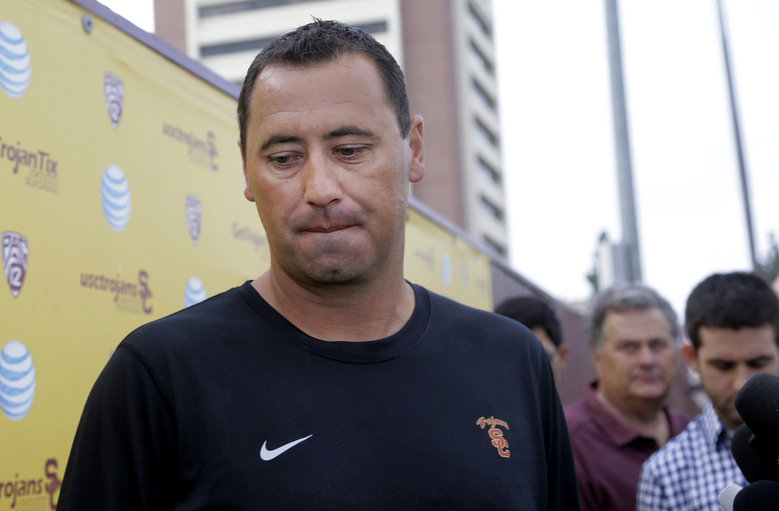 Southern California NCAA college football coach Steve Sarkisian speaks to media before football practice, in Los Angeles, Tuesday, Aug. 25, 2015. Sarkisian publicly apologized for his drunken appearance at a team rally last weekend, attributing his slurred, profane speech to a combination of alcohol and medication. (AP Photo/Nick Ut)