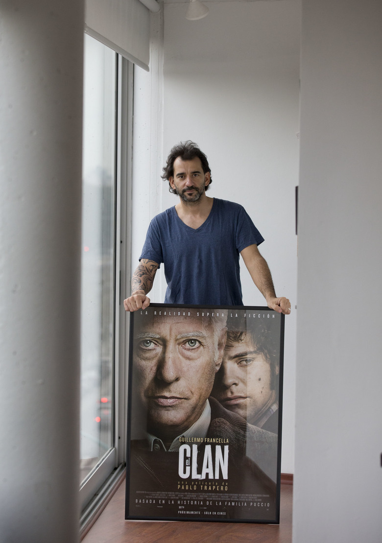 "In this Wednesday, Aug. 26, 2015 photo, Argentine filmmaker Pablo Trapero pose for a picture in Buenos Aires, Argentina. ""The Clan"", the latest film by Trapero, is based on the true story that shocked the Argentina 30 years ago when a psychopathic murderer, that along with the complicity of at least two of his children, set up a business at his home, kidnapping and murdering businessman. (AP Photo/Natacha Pisarenko)"