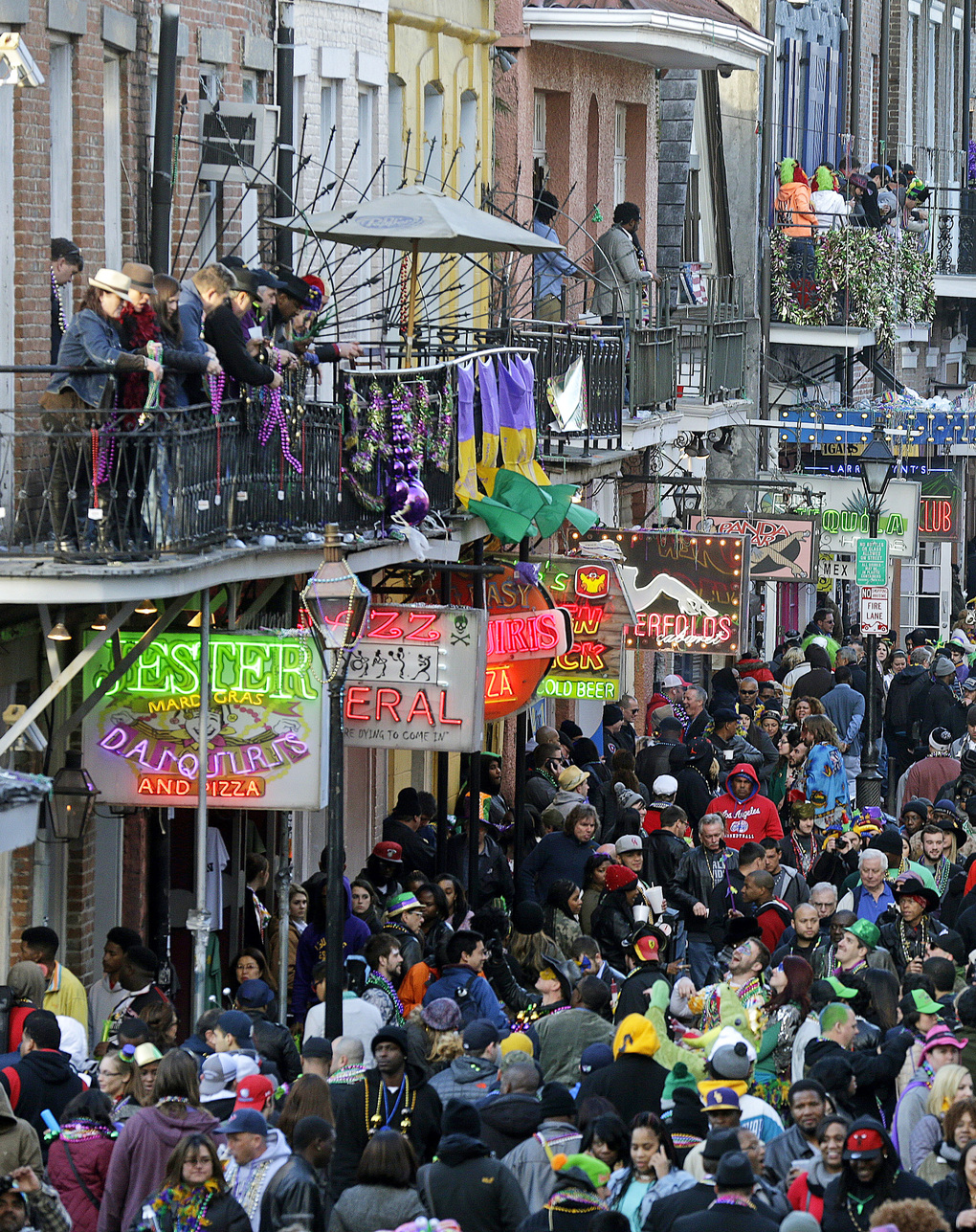 FILE – In this Feb. 17, 2015 file photo, revelers pack Bourbon Street on Mardi Gras day in the French Quarter in New Orleans.  New Orlean's tourism industry has rebuilt, rebounded and modernized in the 10 years since Katrina. (AP Photo/Gerald Herbert, File)