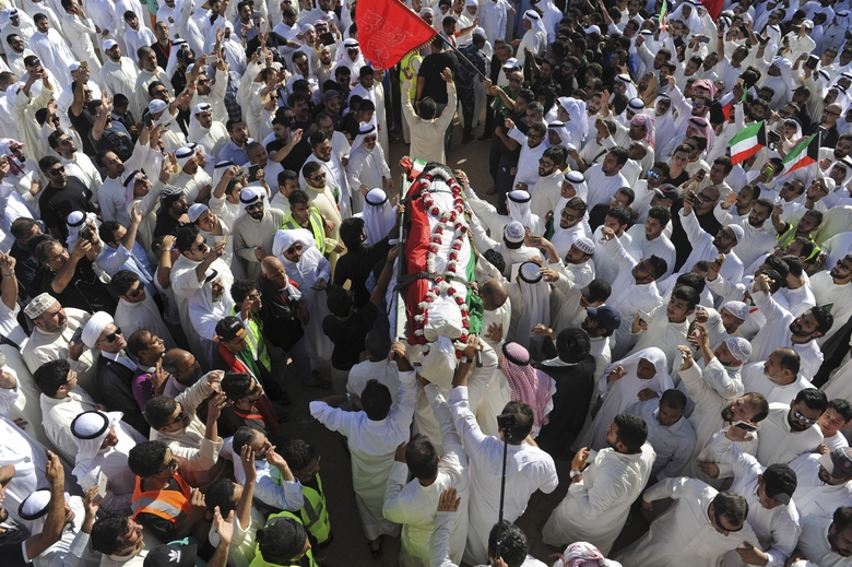 FILE – In this Saturday, June 27, 2015, file photo, thousands of Sunnis and Shiites from across the country take part in a mass funeral procession for 27 people killed in a suicide bombing, by a sympathizer of the Islamic State group, that targeted the Shiite Imam Sadiq Mosque a day earlier, at the Grand Mosque in Kuwait City, Kuwait. The Islamic State group is extending its reach in Saudi Arabia, expanding the scope of its attacks and drawing in new recruits with its radical ideology. Its determination to bring down the U.S.-allied royal family has raised concerns it could threaten the annual Muslim hajj pilgrimage later this month.  (AP Photo, File)