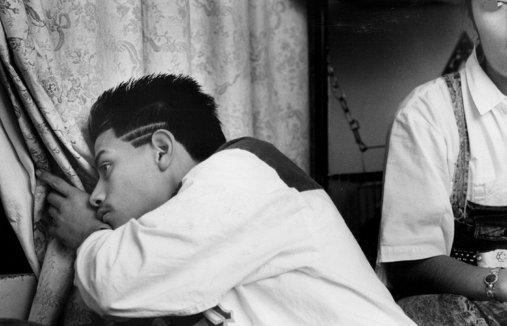 1988: Hugo Madrigal and his sister Adriana, like most Yesler Terrace residents, are prisoners in their apartment after dark due to troublemakers in the streets. Both came to the U.S. from Mexico seven years earlier.  (Alan Berner / The Seattle Times)
