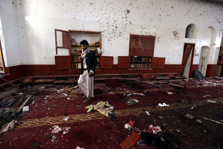 A member of Houthi militia inspects the scene of a triple suicide attack targeting a mosque in Sana'a, Yemen, September 3, 2015. According to reports, at least 32 people were killed and 75 injured in a mosque in the Yemeni capital Sana'a when a car bomb reportedly exploded outside the Muayad mosque after a suicide bomber detonated an explosives belt inside during evening prayers.  EPA/YAHYA ARHAB