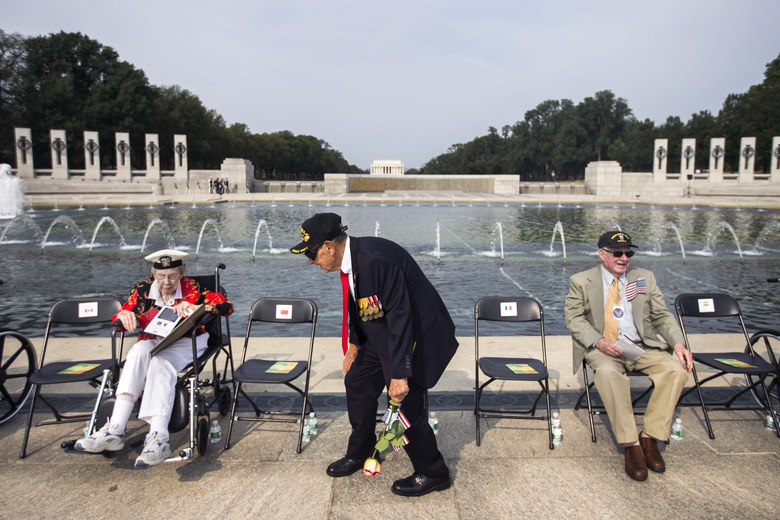 World War II veteran Ernest Yamartino (C) prepares to takes his seat before the start of an event, sponsored by The Friends of the National World War II Memorial and the National Park Service, commemorating the 70th anniversary of the Allied Forces Victory in the Pacific and the effective end of World War II at the World War II Memorial in Washington, DC, USA, September 2, 2015. On September 2, 1945, Japan formerly surrendered aboard the battleship USS Missouri, marking the end of World War II.  EPA/JIM LO SCALZO