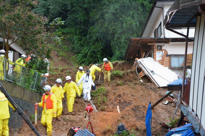 Rescuers search for a missing resident in Kanuma, Tochigi prefecture, north of Tokyo Thursday, Sept. 10, 2015. Heavy rains batter Japan for the second day, causing flooding and landslides in eastern Japan. (Kyodo News via AP)