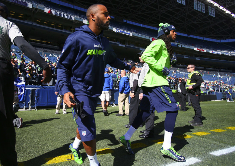 Seahawks wide receiver Doug Baldwin, left, and Seahawks corner back Richard Sherman enter the field for warm ups before the game on Sunday. (John Lok / The Seattle Times)
