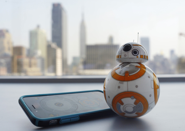 "This Thursday, Sept. 3, 2015 photo shows Sphero's BB-8 droid toy in New York. The BB-8 is controlled with a smartphone or tablet app and responds to basic voice commands such as ""wake up,"" and ""look around."" It's just under 5-inches tall and makes cute little Droid sounds reminiscent of R2-D2. (AP Photo/Patrick Sison)"