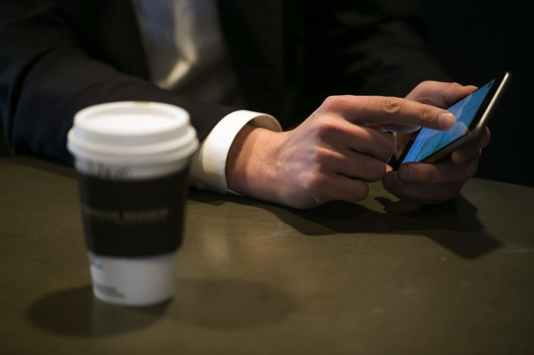 Starbucks' mobile ordering and pay feature was pioneered in Portland last December, and shortly thereafter was released in hundreds of stores across the Pacific Northwest.  (BETTINA HANSEN/The Seattle Times)