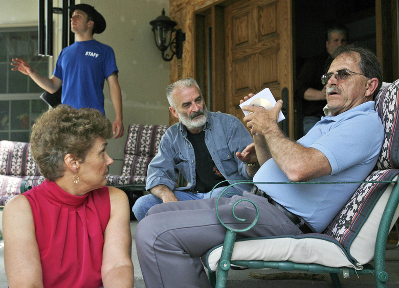 FILE – In this June 18, 2007, file photo, Ed Brown, right, and his wife Elaine Brown listen to Ruby Ridge survivor Randy Weaver, center, at their home in in Plainfield, N.H. Federal officials will try again in October, 2015, to sell New Hampshire properties formerly owned by the now-jailed tax militants. The first auction in 2014 failed to field any bidders, in part because potential buyers couldn't tour a 100-acre section of the property out of concern it may have been booby-trapped. (AP Photo/Jim Cole, File)