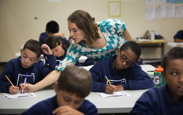 Cristina Marcalow teaches a sixth-grade humanities class at Excel Public Charter School in Kent on Tuesday.  (Ellen M. Banner/The Seattle Times)
