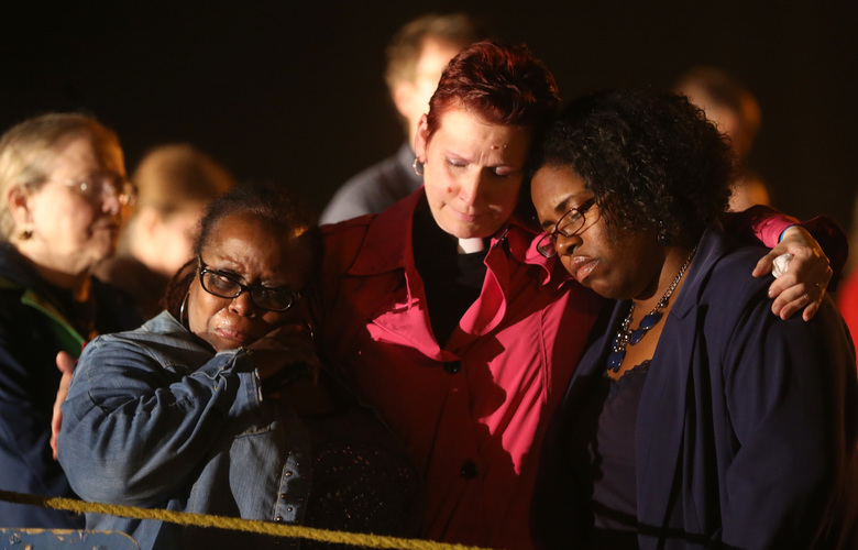 Dorinda Tatum, left, Rev. Michelle Ledder, center, and Cassandra Henderson react after hearing that Kelly Renee Gissendaner had been executed just after midnight on Wednesday, Sept. 30, 2015, at Georgia Diagnostic Prison in Jackson, Ga. Gissendaner was convicted of murder in the February 1997 slaying of her husband. (Ben Gray/Atlanta Journal-Constitution via AP)  MARIETTA DAILY OUT; GWINNETT DAILY POST OUT; LOCAL TELEVISION OUT; WXIA-TV OUT; WGCL-TV OUT; MANDATORY CREDIT