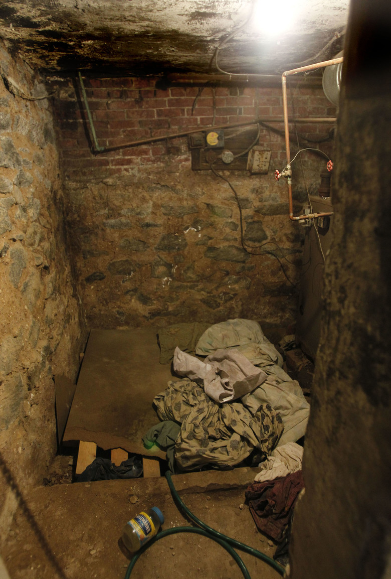 FILE – This Oct. 17, 2011 file photo shows the sub-basement room in Philadelphia where four weak and malnourished mentally disabled adults, one chained to the boiler, were found locked inside.  Linda Weston, accused of keeping mentally disabled adults captive in the basement for their disability checks has pleaded guilty, Wednesday, Sept. 9, 2015,  to all counts in a deal that will spare her a possible death sentence.  (Ron Cortes/The Philadelphia Inquirer via AP, Pool)