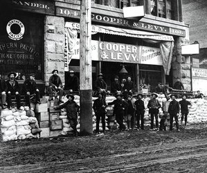 1897 prospectors watch stacks of supplies outside the Cooper & Levy Pioneer Outfitters store in downtown Seattle. (WASHINGTON STATE JEWISH HISTORICAL SOCIETY, UW LIBRARIES) –